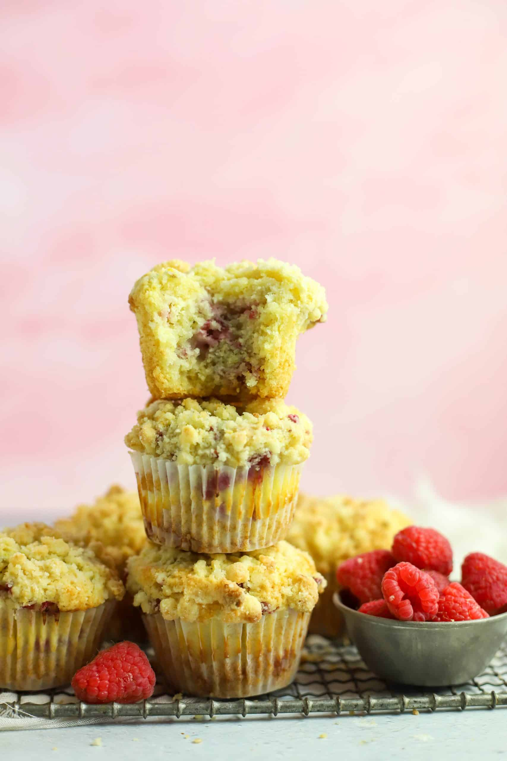 three raspberry cream cheese muffins stacked