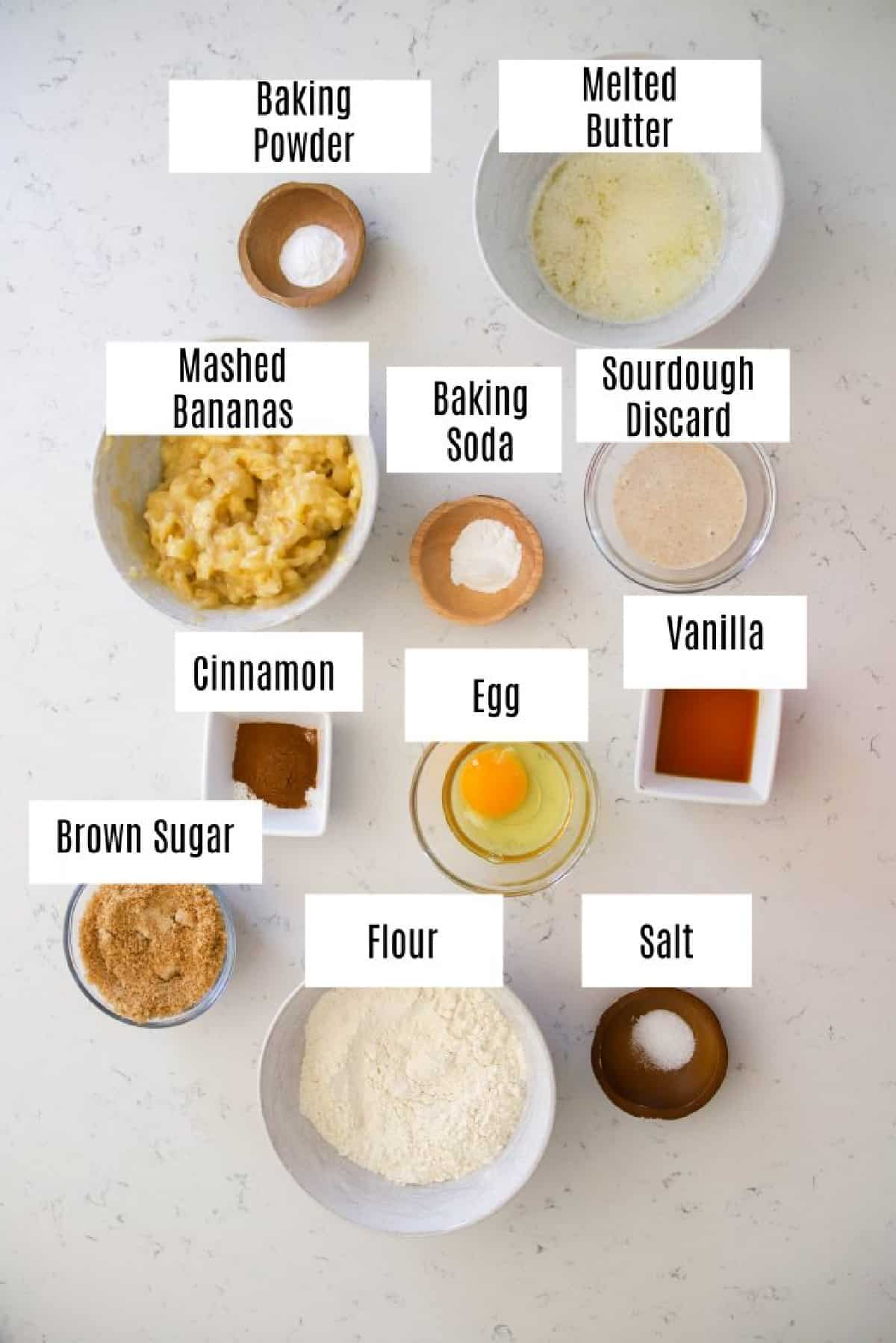 ingredients for banana sourdough muffins prepped in small bowls