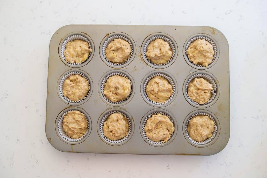 unbaked sourdough muffins in a muffin tin