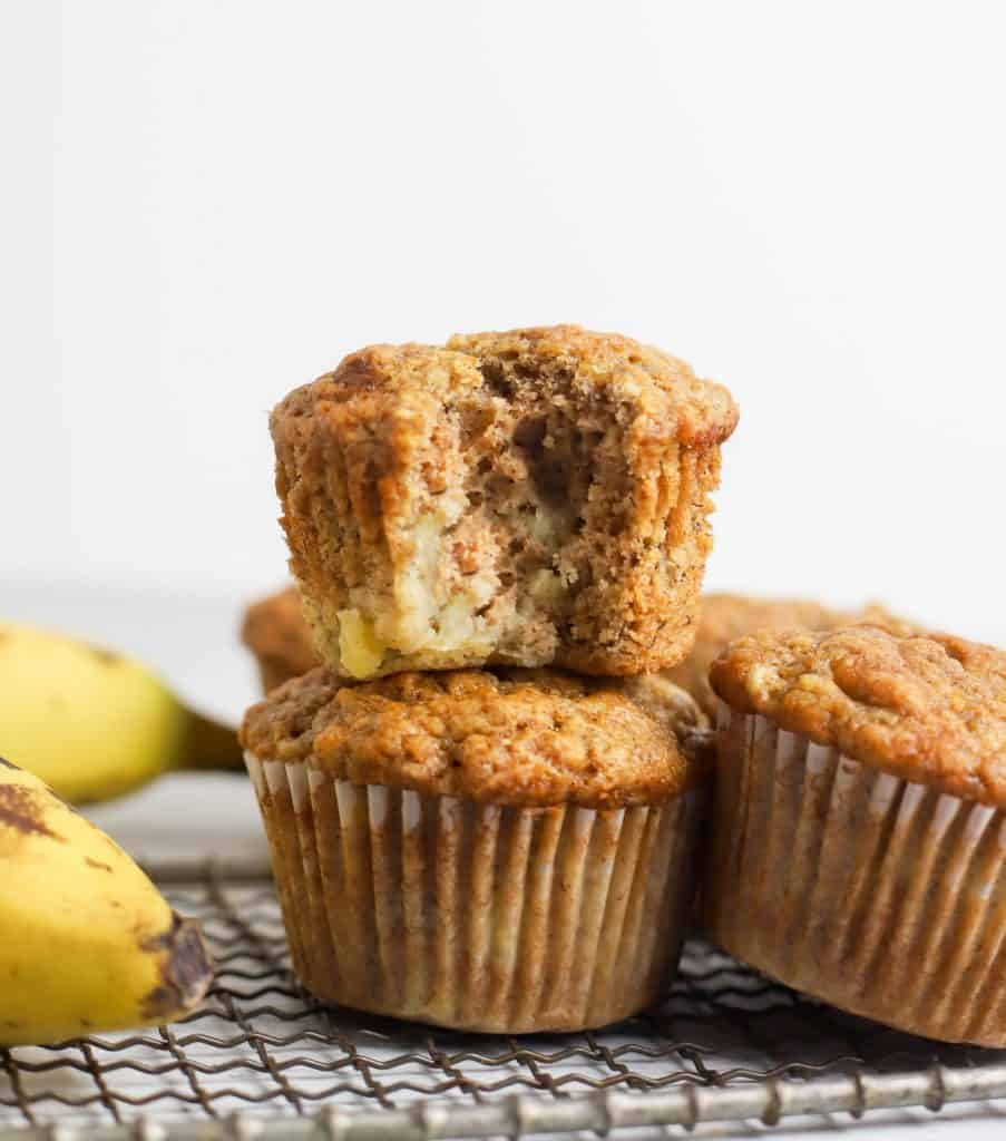 two sourdough banana muffins stacked on top of each other