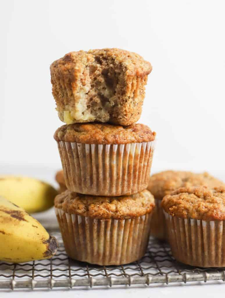 three banana muffins stacked on top of each other
