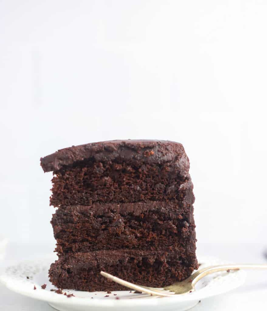 slice of sourdough chocolate cake on a plate standing upright