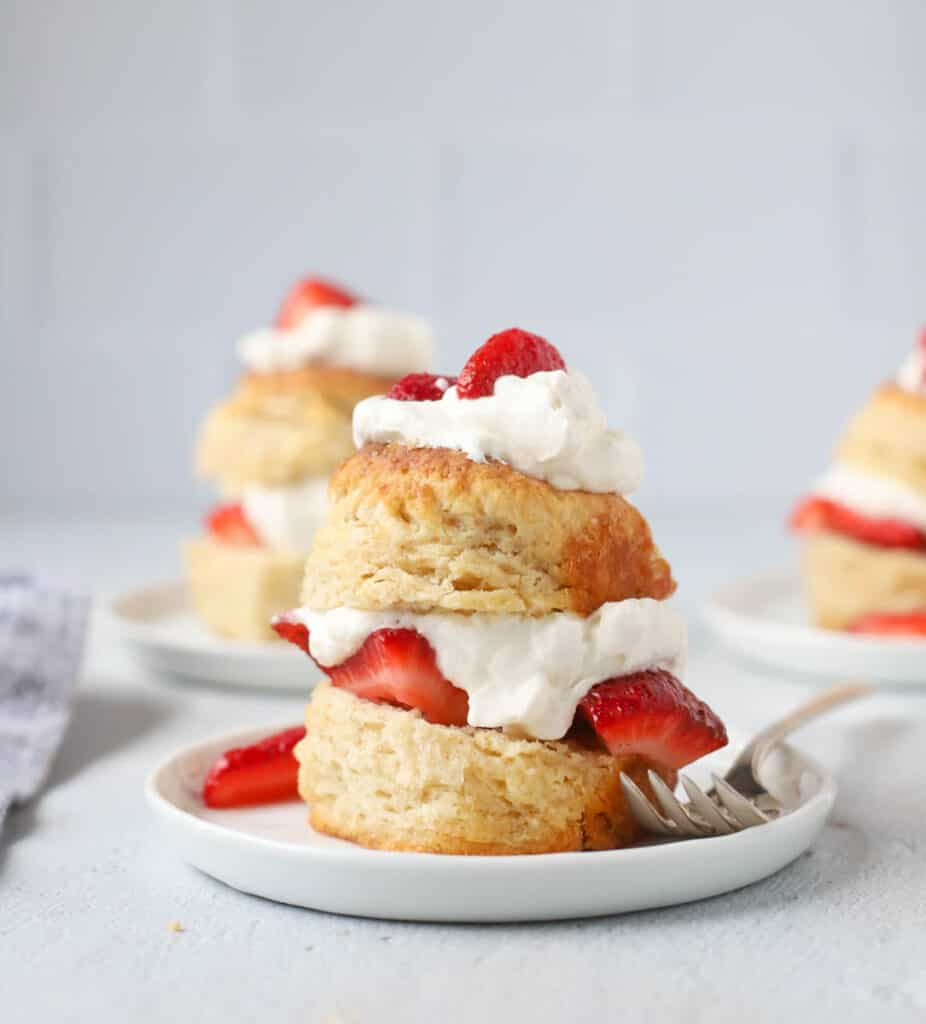 strawberry shortcake on sourdough biscuits on a plate with a fork