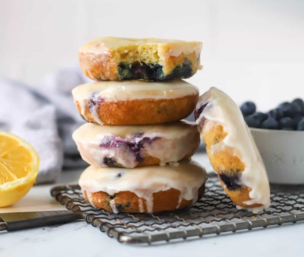 baked blueberry donuts piled up
