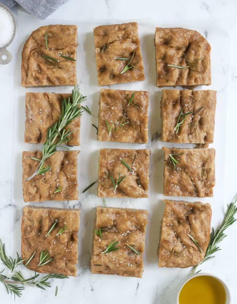 rosemary rye sourdough focaccia cut into squares