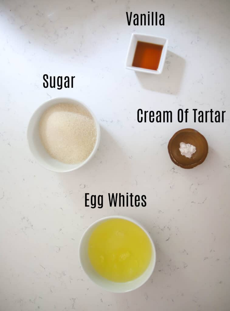 ingredients prepped in small bowls for marshmallow frosting