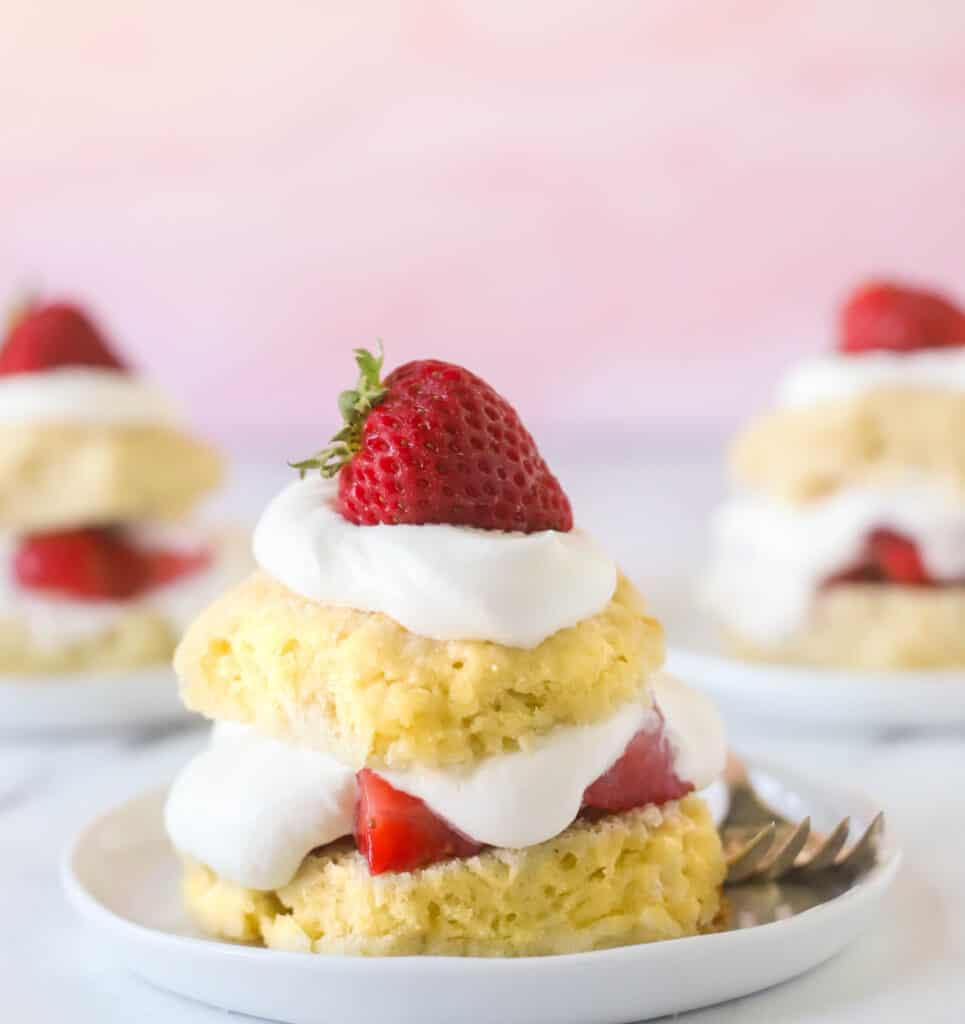 strawberry shortcake on a plate with a fork
