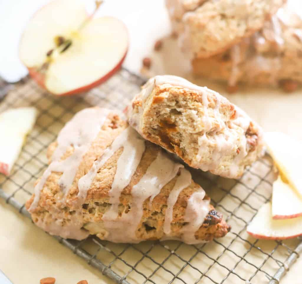 two apple scones, one has a bite taken out of it