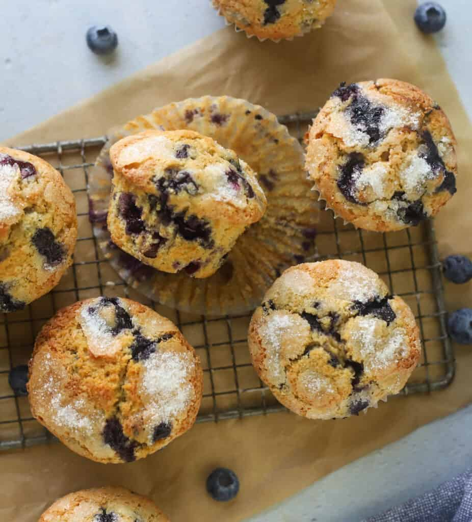 whole wheat blueberry muffins on a wire rack