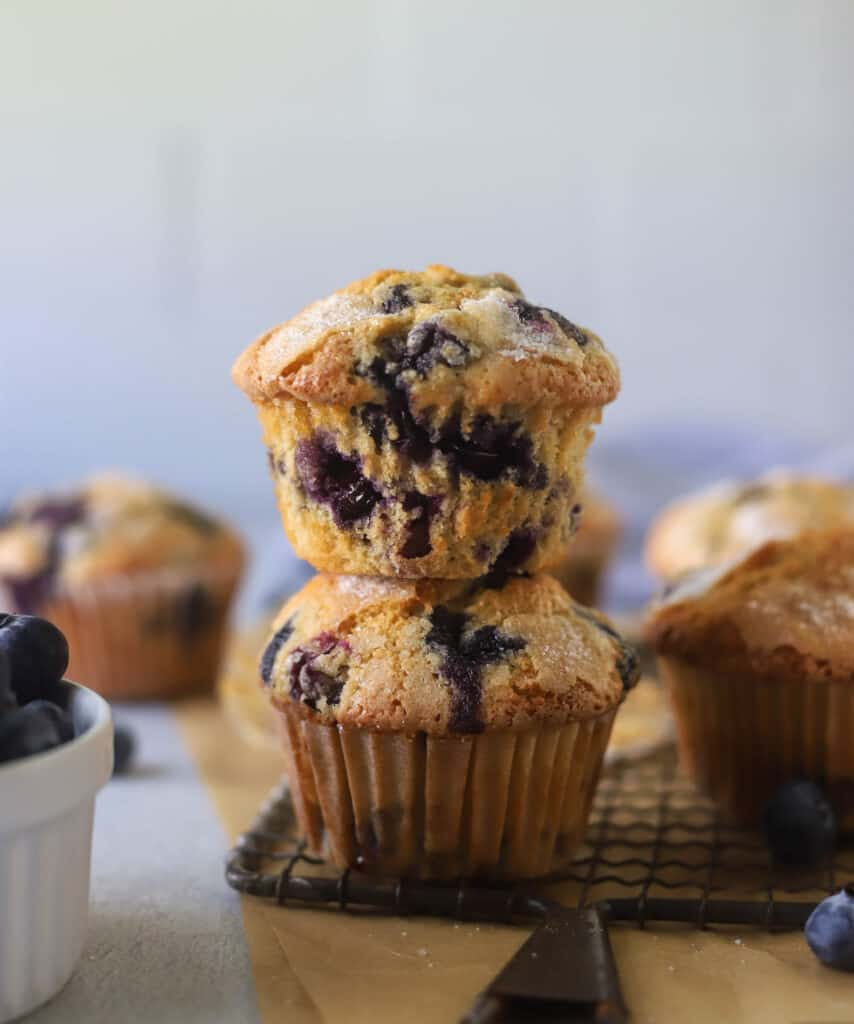 two blueberry muffins stacked on top of each other