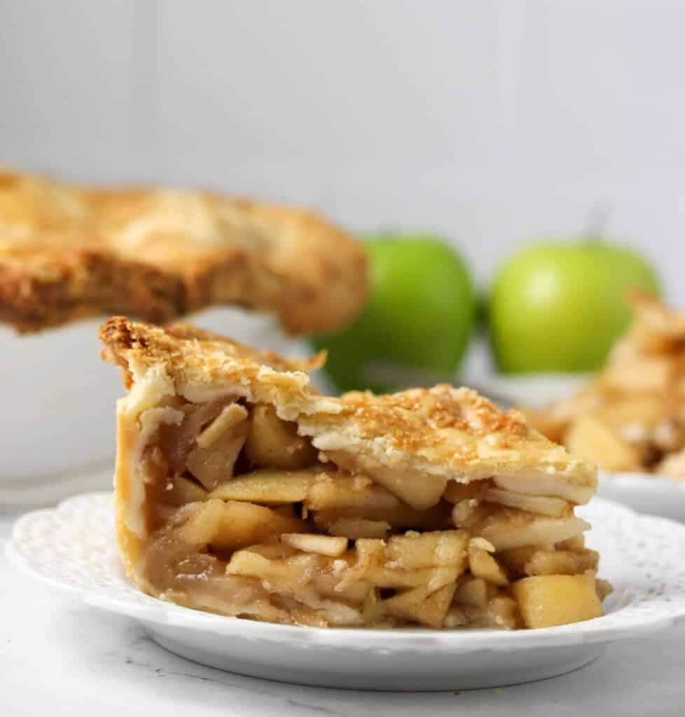slice of deep dish apple pie on a plate