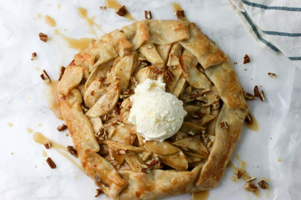 whole apple crostata topped with scoop of ice-cream
