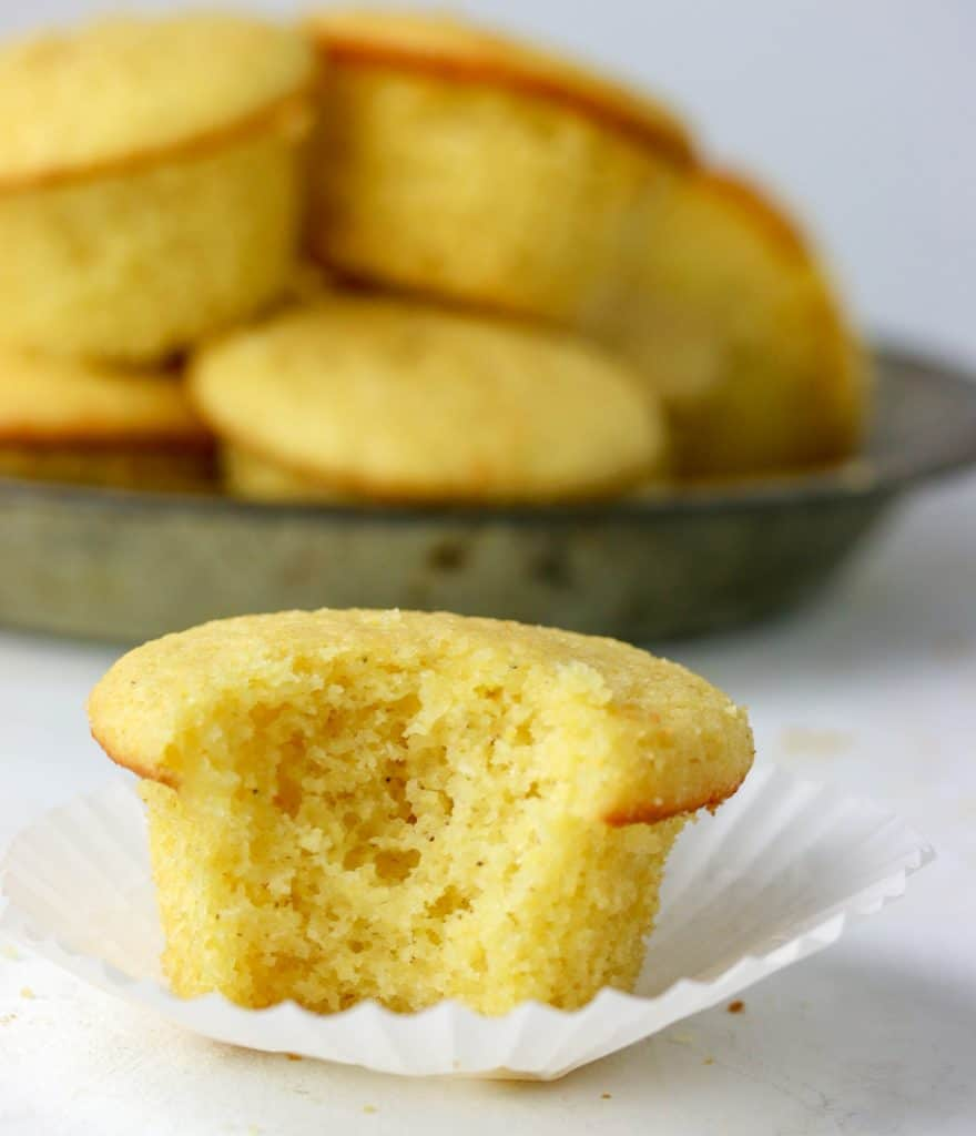 cornbread muffin with a bite taken out of it