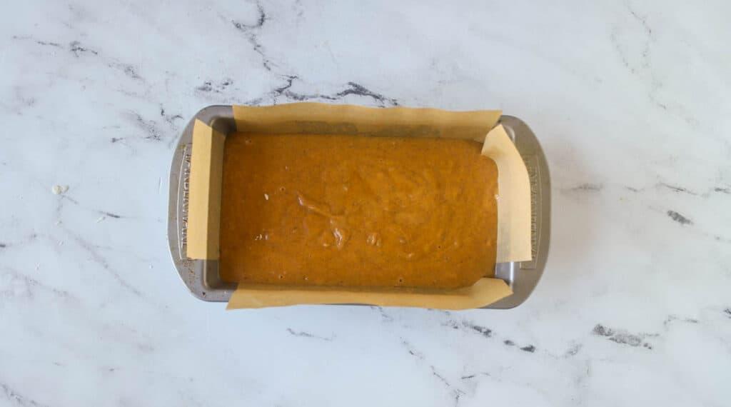 unbaked sourdough pumpkin bread in a loaf pan