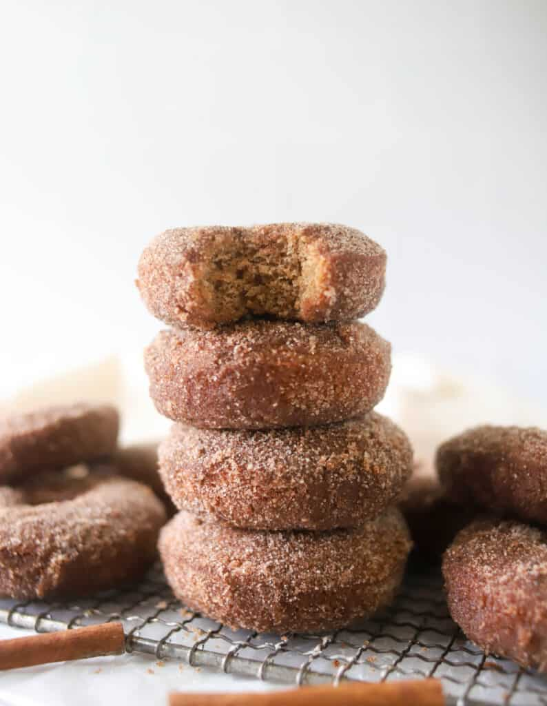 four apple cider donuts stacked