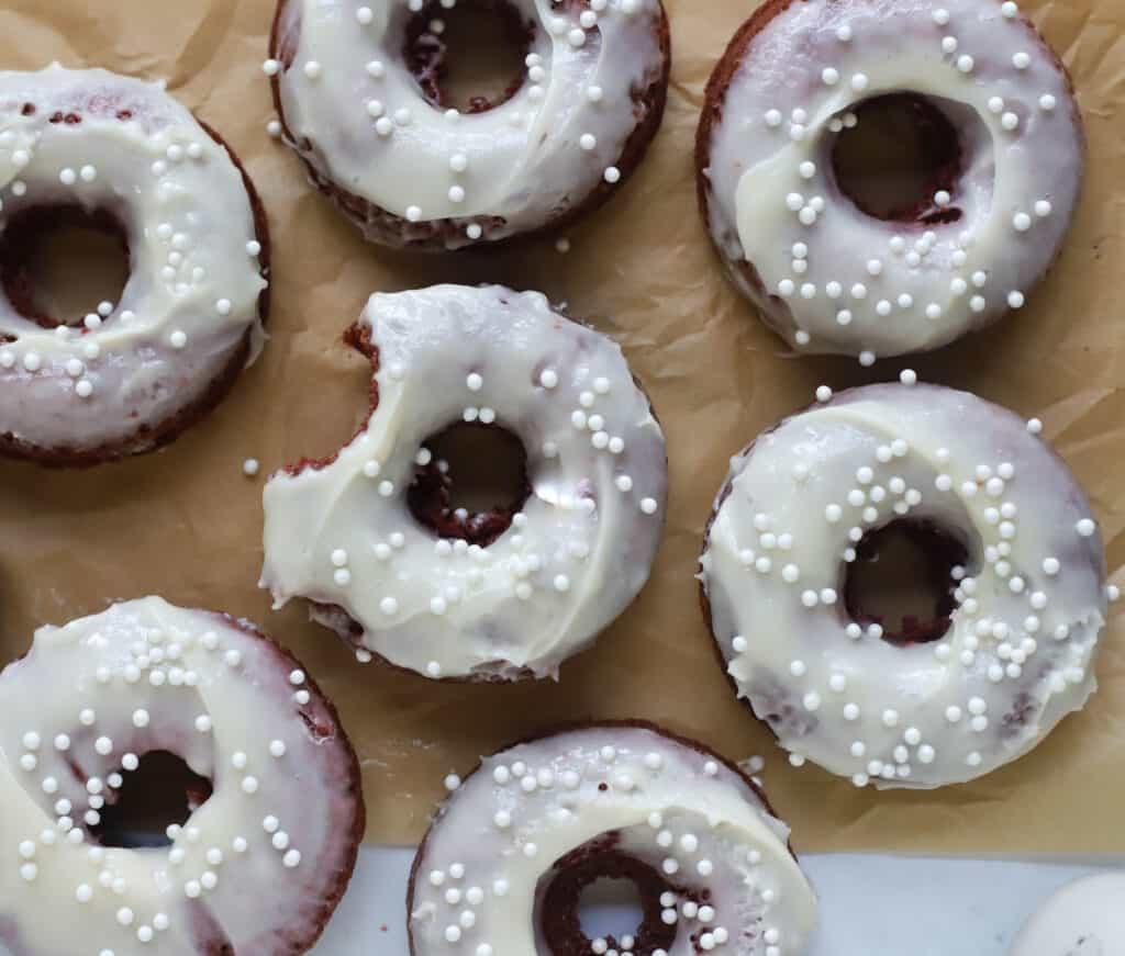red velvet donuts on parchment paper